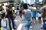 Juneteenth Celebration, crowd of people with man holding snake