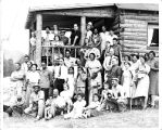 YMCA Glenarm Branch Group Photo in front of Log Cabin