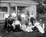 Large family in front of residence
