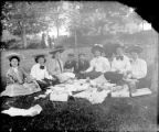Small family group having a picnic