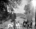 Two men each with three greyhounds