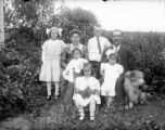 Family photo: couple with five children and a dog