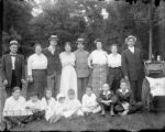 Group of children and adults posed for picture