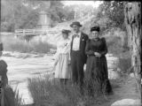 Man woman and girl beside stream