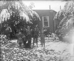 Five children standing outside of residence