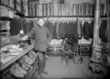 Man in store with clothing and luggage