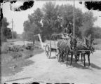 Horse-drawn wagon after crossing bridge