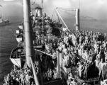 Troops aboard the Marine Fox return to New York Harbor