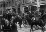 President Theodore Roosevelt riding on a carriage through Denver