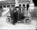 Mr. & Mrs. Harry Fisher Rhoads with electric car at City Park pavilion