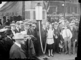 Group in front of Rocky Mountain News building at 17th Street and Glenarm Place in the Continental...
