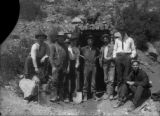 Harry Rhoads with others in front of a working mine