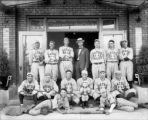 "Charles C. Gates, center-not in uniform, with ""Gates Half-Sole"" team"