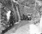 Automobile near a waterfall