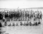 """Life Saver"" and group of children in swimsuits"