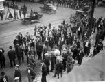 Crowd of men on street corner