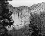 Pajarito Park Ruins James Plateau cliff with cave dwelling ruins- large caves at bottom