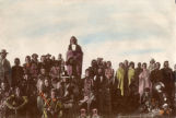 Little Bear, the Cree Chief, is standing highest at center, these are the people who were settled...