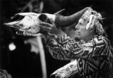 Iron Eyes Cody holds buffalo skull aloft during ceremonies