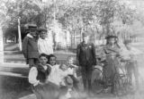 Group of boys and girls - two with bicycles