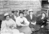 Group of young men & women (hats and suits)