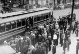 Men board a trolley