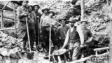 Group of miners working No. 6 below Hunker