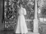 Woman stands on porch