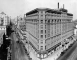 Seventeenth Street, the banking and hotel district of Denver, and Union Station in distance
