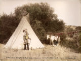 Plenty Bird and wife beside their tepee, Cheyenne res
