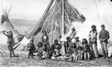 Washakie by tent with family and visitor soldier from hospital