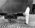White wing and cart of the street cleaning dept.