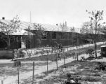 Evacuee barracks showing gardens and trees