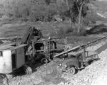 San Jaun [i. e. Juan] Metals Corp. loading dirt from river bed into Trummal [i. e. trommel]