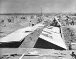 Typical scene of barracks construction with the prefabricated section lying in position