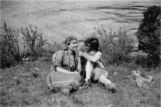 White man and woman dressed as Native Americans