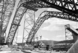 The structural arches being assembled would eventually carry the ore conveyor system, moving...