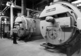 These huge boilers at the Henderson Mine heat water for surface domestic heat