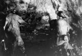 "Woman miner, right, works along side male counterpart on ""jumbo"" drill sharing equally..."