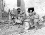 Soldiers eating around a jeep