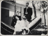 Family poses near a hammock