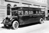 "Bus #3 ""Fadgel"" of D. T. C. at 18th & Lawrence at Denver City Cable Rwy Co bldg"