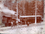 Men near Manitou and Pikes Peak Railway Company train