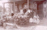 Men, women and girls on a porch