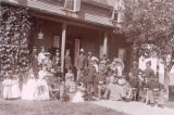 Officers and families on a porch