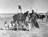 Unidentified group of Indians, oxen in background