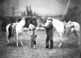 Chief Joseph and Captain Jerome with Buffalo Bill's horses, full length