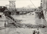 Preparing to dynamite D. & R.G. Bridge from sands in river bed