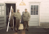 Three 10th men at the door of the 110th Signal Corps Company Barracks, Camp Hale