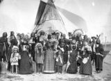 Mrs. Edward Kidder with group in front of teepee